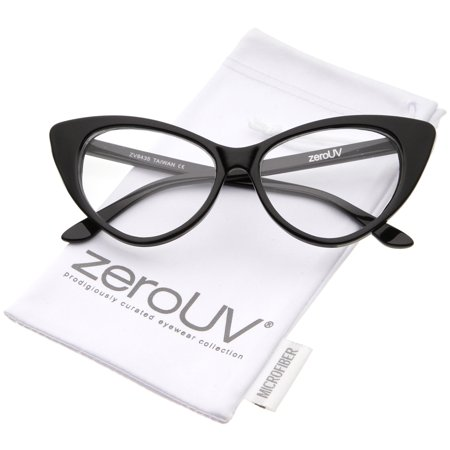 zeroUV - Retro High Sitting Temples Clear Lens Exaggerated Cat Eye Glasses 55mm (Black / Clear) - 55mm Add a 50's inspired touch to your look with these cat eye glasses featuring an exaggerated high point silhouette and teardrop-shaped clear lenses. Accented with stylishly high sitting temples, these bold and retro eyeglasses are the perfect combination of chic and sophisticated. Made with a plastic based frame, metal hinges, and polycarbonate UV400 clear lenses.