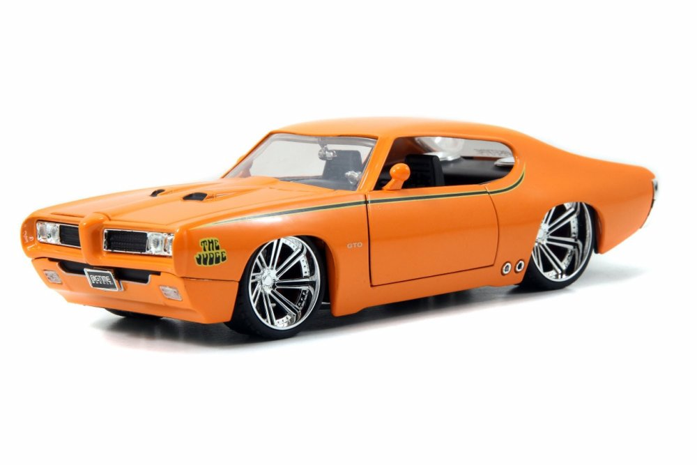 1969 Pontiac GTO Judge, Orange Jada Toys 90217 1 24 scale Diecast Model Toy Car (Brand but... by Jada
