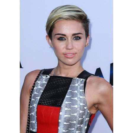 Miley Cyrus At Arrivals For Paranoia Premiere Canvas Art     16 X 20