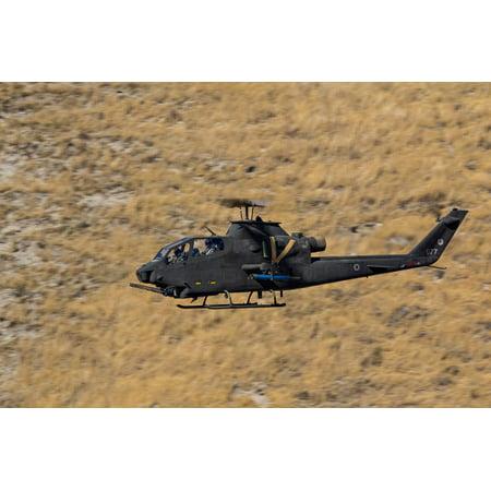 An AH-1F Tzefa of the Israeli Air Force flying over Israel Poster Print by Ofer ZidonStocktrek Images