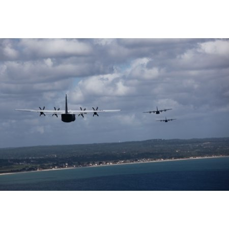 Canvas Print Three U.S. Air Force C-130Js, assigned to the 37th Airlift Squadron, flies toward the coast of Norma Stretched Canvas 10 x
