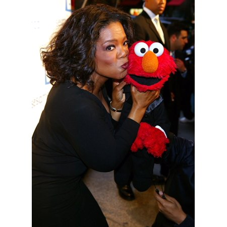 Tv Host Oprah Winfrey And Friend Elmo Kiss At The Sesame WorkshopS Second Annual Benefit Gala At CiprianiS 42Nd St June 2 2004 In New York City Celebrity - Elmo 2 In 1 Walker