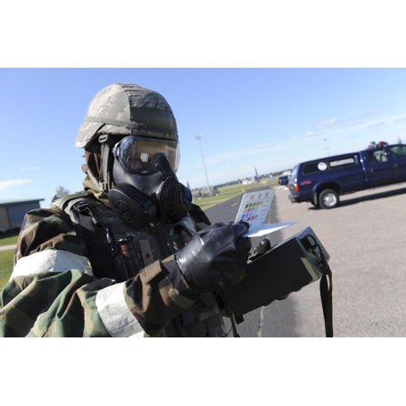 September 13 2011 - Soldier uses an M256 Kit to identify a simulated chemical type that was used during a chemical attack at Volk Field Wisconsin Poster Print ()