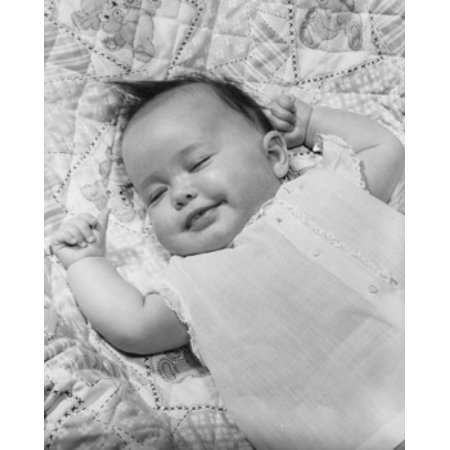 High angle view of a baby girl smiling and sleeping Canvas Art - (24 x 36)