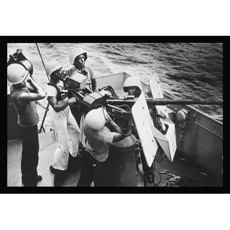 Gun Crew Stands - Five stewards mates stand at their battle stations as a gun crew aboard a Coast Guard-manned frigate in the southwest Pacific On call to general quarters these Coast Guardsmen man a20mm AA gun They ar