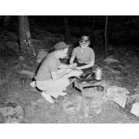 Young couple preparing food and drink on barbecue grill Canvas Art -  (24 x 36) Young couple preparing food and drink on barbecue grill Canvas Art -  (24 x 36)