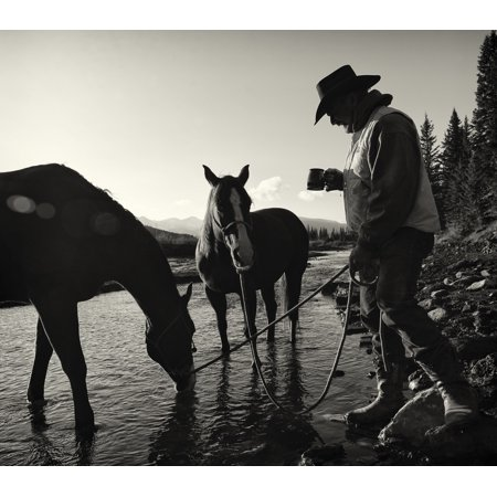 Cowboy Having His Morning Coffee At The Edge Of A River With His Horses Ya Ha Tinda Ranch Clearwater County Alberta Canada Poster Print By Deb Garside  Design Pics