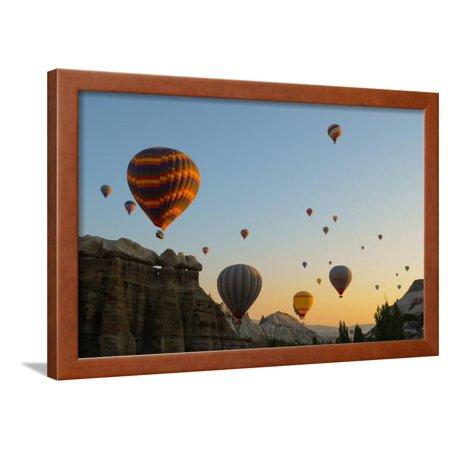 Hot Air Balloons Cruising over Cappadocia, Anatolia, Turkey, Asia Minor, Eurasia Framed Print Wall Art By James Strachan