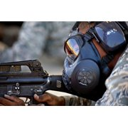 Air Force Basic Military Training trainee fires at his target while wearing his gas mask Poster Print