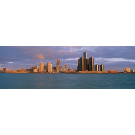 This is the skyline and Renaissance Center at sunrise It is a view of what they call the Motor City from Windsor Canada It shows the Detroit River in the foreground Poster Print