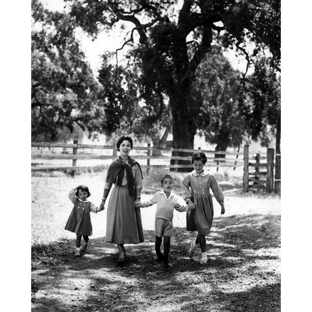 Shirley Temple walking with her children Photo Print