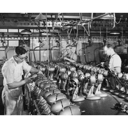 Posterazzi Manual workers assembling electric fans at a factory Canvas Art -  (24 x 36) Manual workers assembling electric fans at a factory Canvas Art -  (24 x 36)