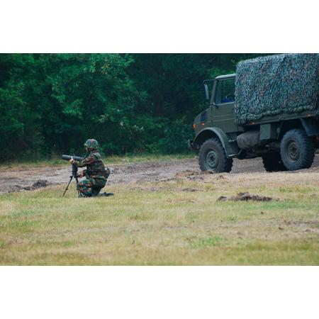 A soldier of the Belgian artillery unit sets up a device toguide howitzer units Poster Print by Luc De JaegerStocktrek Images