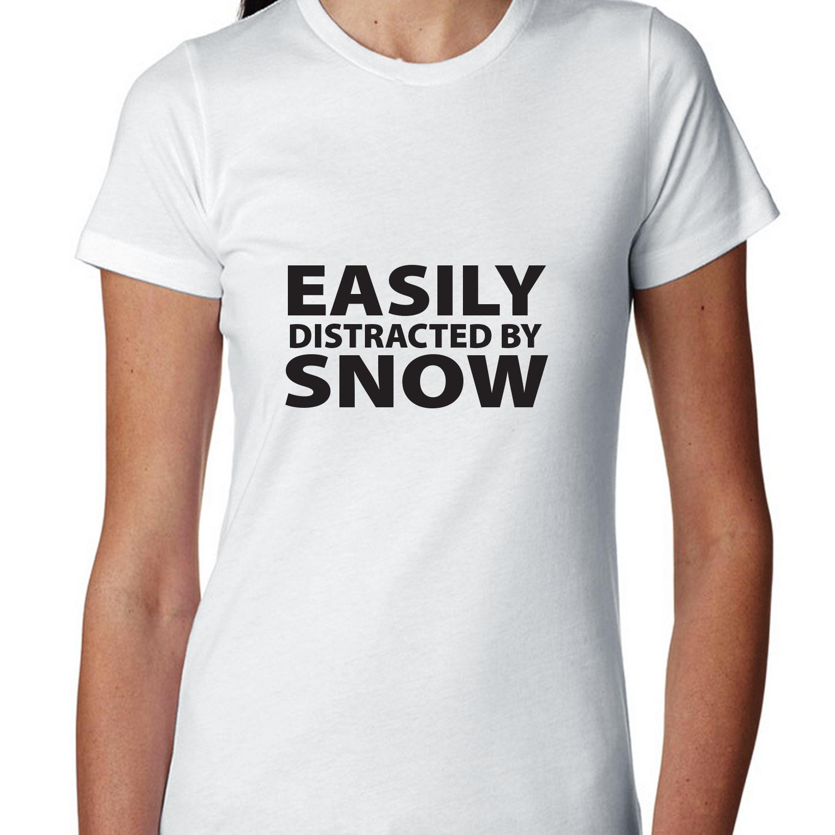 Easily Distracted By Snow Skiing Snowboarding Women's Cotton T-Shirt by Hollywood Thread
