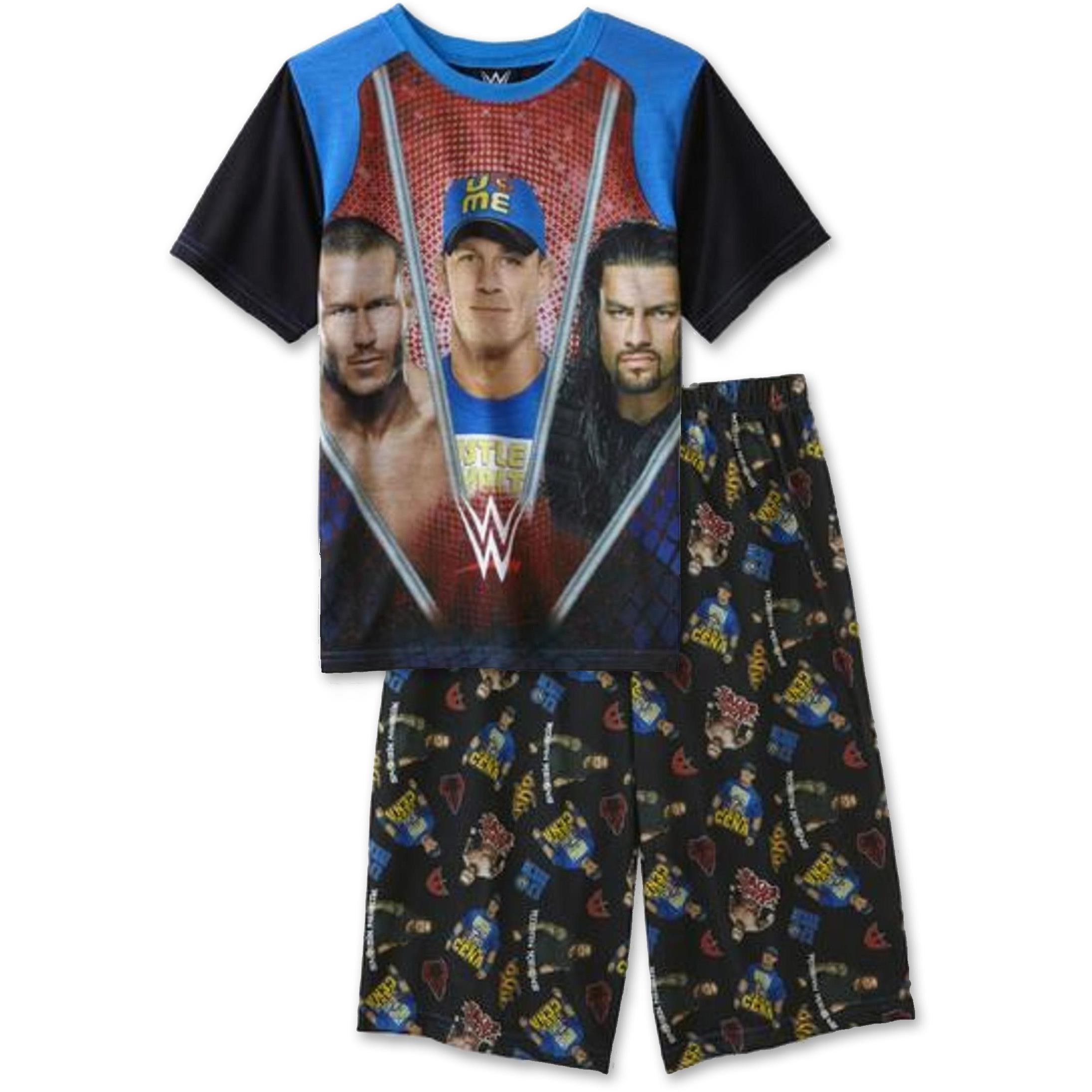 WWE The Rock Adult Footed Pajamas $ Ex Tax: $ These pajamas feature hoody, thumb holes, logo zipper pull, pockets and a left shoulder iPhone pocke.