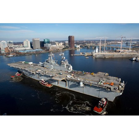 Tugboats position the amphibious assault ship USS Kearsarge Poster Print by Stocktrek Images