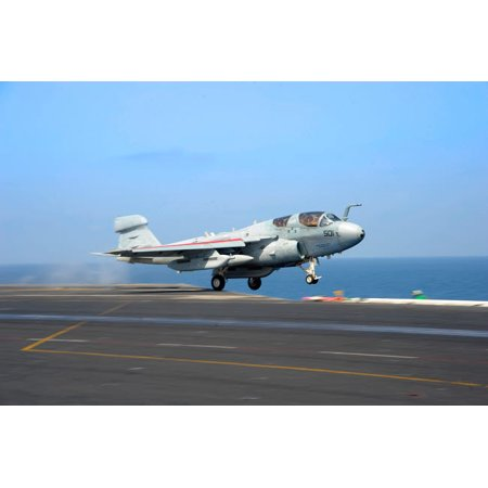An EA-6B Prowler launches from the flight deck of USS Dwight D Eisenhower Poster Print by Stocktrek Images