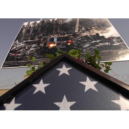 Canvas Print A folded American flag sits under a photo of the devastation of the Twin Towers in New York City. Me Stretched Canvas 10 x 14