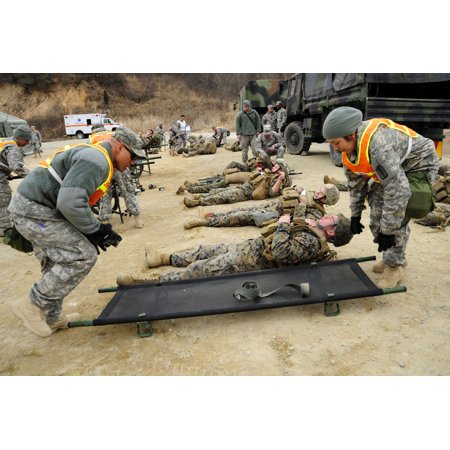 - LAMINATED POSTER Army personnel assigned to Bravo Company, 121st Combat Support Hospital, based out of Camp Yungsan, Poster Print 24 x 36