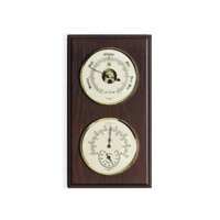 Barometer & Thermometer With Hygrometer On Mahogany Wood