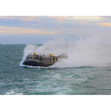 Atlantic Ocean March 13 2013 - A landing craft air cushion enters the well deck of the amphibious dock landing ship USS Carter Hall Poster Print