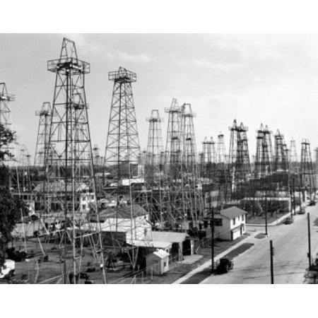 Oil drilling rigs at an oil industry Kilgore Texas USA Stretched Canvas -  (8 x 10) 10 Stretched Canvas