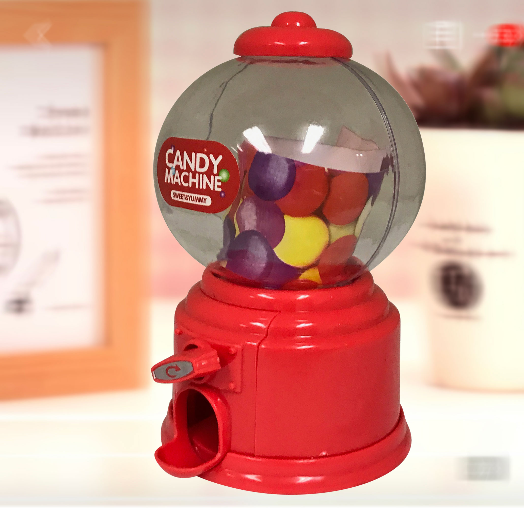 Gumball Machine. Red Candy Machine/ Dispenser. Put your favorit candies inside. Desk-top portable. Product Size: 3.5 x 6 x 3.5 ;