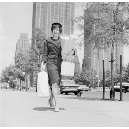 Woman walking on street with shopping bags Canvas Art -  (18 x 24) Woman walking on street with shopping bags Canvas Art -  (18 x 24)
