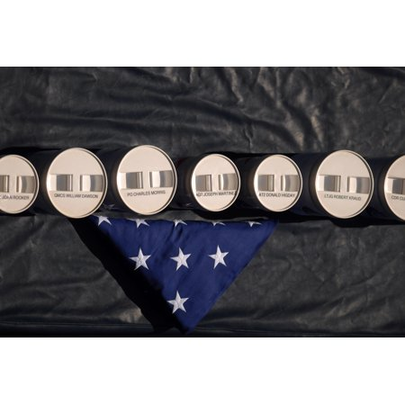 Canvas Print A folded American flag is placed next to the remains of nine military veterans, including retired U Stretched Canvas 10 x (10 Best Places To Retire)