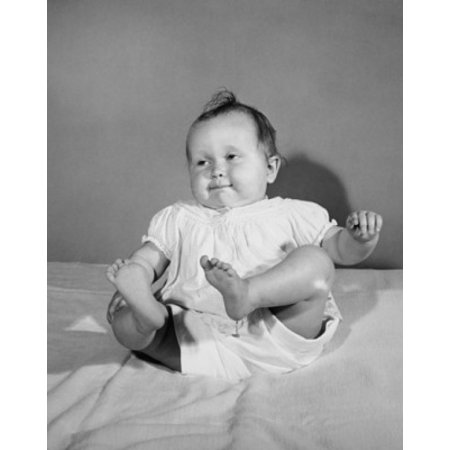 Baby girl sitting on a blanket Canvas Art - (18 x 24)
