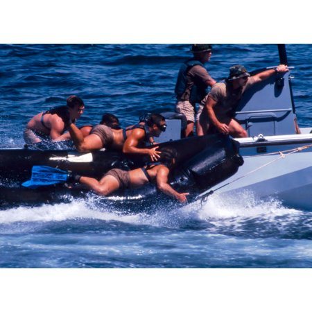 Navy SEALs practice high speed boat cast and recovery Poster Print by Michael WoodStocktrek Images