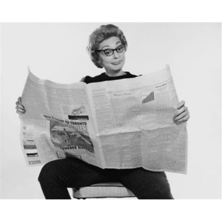Posterazzi SAL25541825 Mid Adult Woman Reading a Financial Newspaper & Making a Face Poster Print - 18 x 24 in. - image 1 de 1