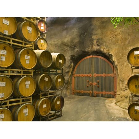Oak Barrels Stacked Outside of Door at Ironstone Winery, Calaveras County, California, USA Print Wall Art By Janis Miglavs