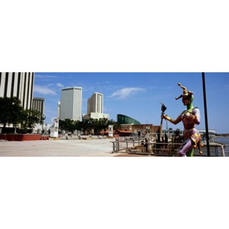 Jester statue with buildings in the background Riverwalk Area New Orleans Louisiana USA Poster Print