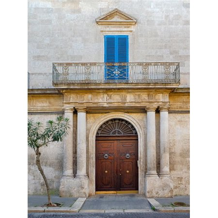 Italy, Puglia, Brindisi, Itria Valley, Ostuni. Beautiful wooden door with balcony above and blue shutters Poster Print by Julie Eggers ()