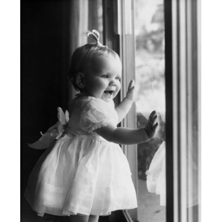 Close-up of a baby girl standing near a window Canvas Art - (18 x 24)