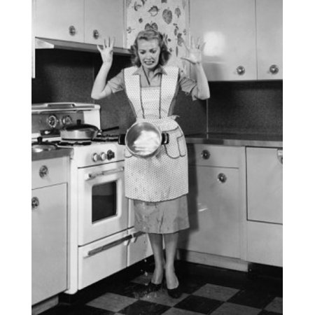 - Young woman dropping a hot pot in front of a stove Poster Print