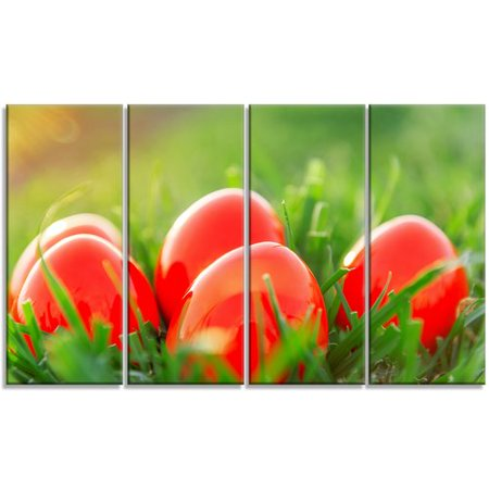 Design Art 'Red Easter Eggs in Green Grass' 4 Piece Photographic Print on Wrapped Canvas - Red Easter Grass