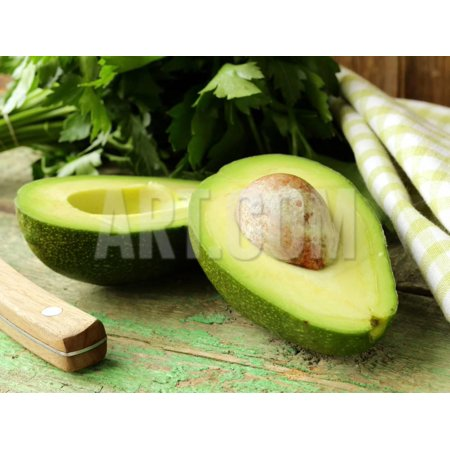 Ripe Avocado Cut in Half on a Wooden Table Print Wall Art By Olga (Best Way To Store Avocado Half)