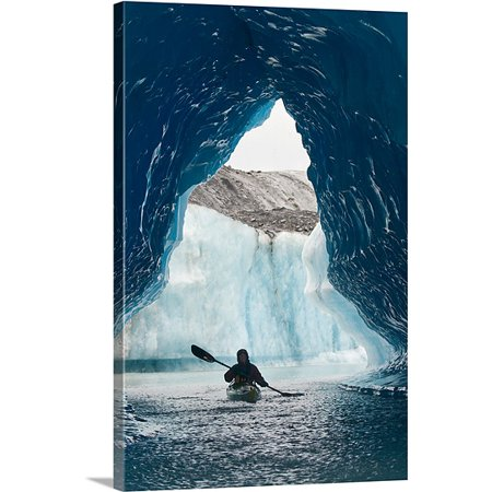 Premium Canoe Paddle Wall Decor - Great BIG Canvas Doug Demarest Premium Thick-Wrap Canvas entitled Sea Kayaker paddles through an ice cave amongst giant icebergs near