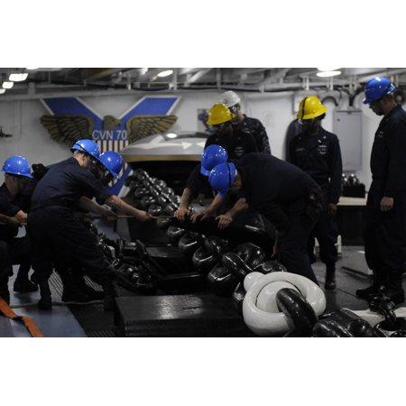 LAMINATED POSTER U.S. sailors attach a chain stopper to the anchor chain aboard the aircraft carrier USS Carl Vinson Poster Print 24 x 36