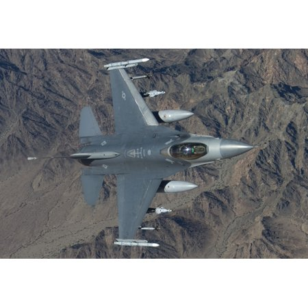 A 56th Fighter Wing F-16 Fighting Falcon from Luke Air Force Base Arizona manuevers during a training mission Poster Print