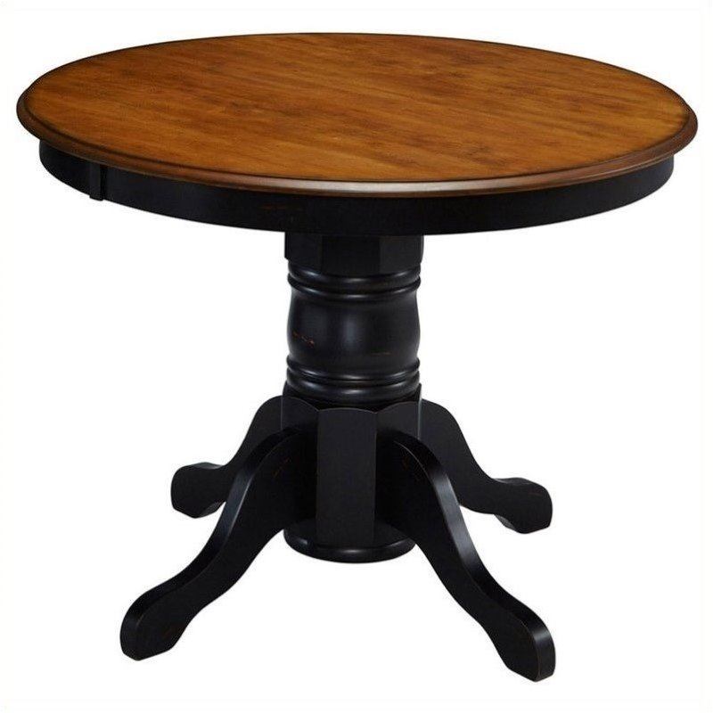 Bowery Hill Round Pedestal Dining Table in Oak and Rubbed Black by Bowery Hill