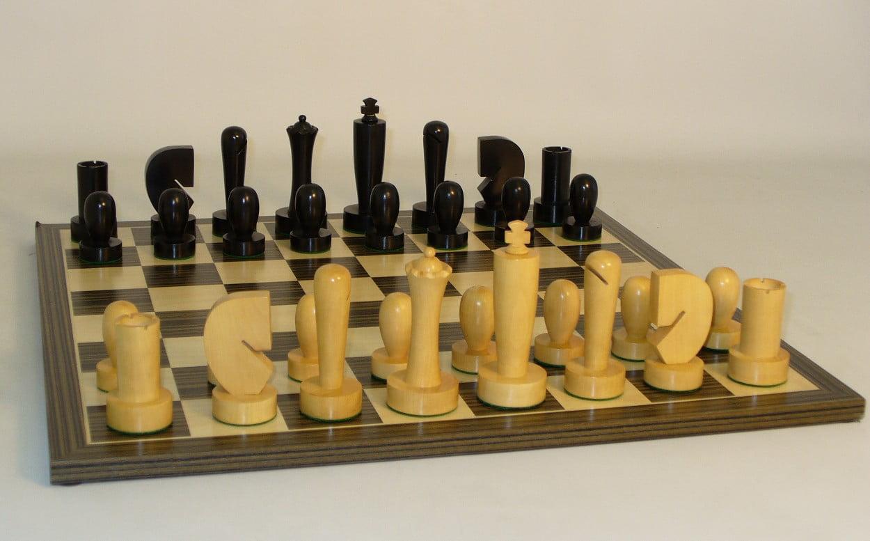 Black Berliner Chessmen on Ebony veneer Chess Board by WorldWise Imports