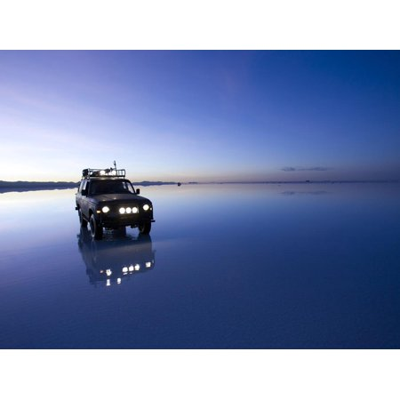 Flax Floods (A 4X4 Rests in the Early Am Reflection in a Flooded Salt Flat In Print Wall Art By Sergio Ballivian)