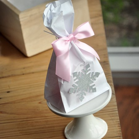 Winter Wonderland Favor Bags (10CT). Silver and Baby Pink Party Supplies. Mini Snowflake Favor Bags with Bows. W36MFB.