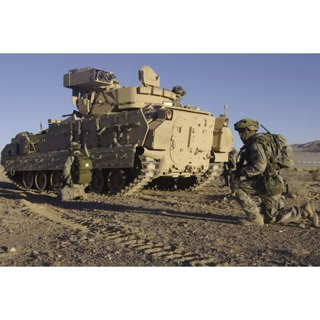 January 24 2007 - US Army Soldiers provide security with an M2 Bradley Fighting Vehicle outside a mock town during the National Training Center 0704 mission readiness exercise at Fort Irwin