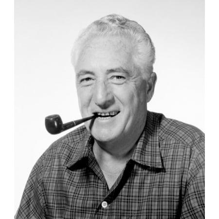 Studio portrait of man smoking pipe Canvas Art - (24 x 36)