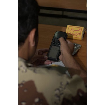 An Iraqi Army lieutenant learns how to use a handheld GPS device Poster Print by Stocktrek Images thumbnail