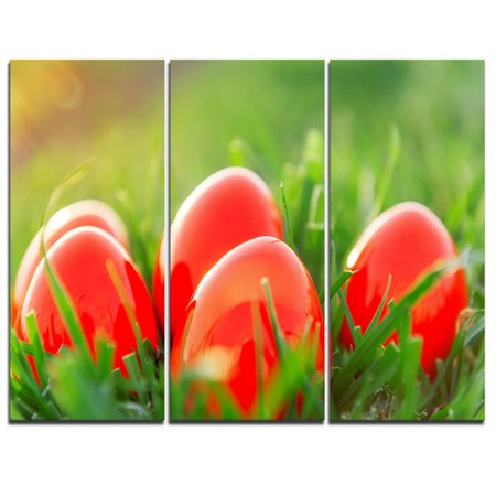 Design Art Red Easter Eggs in Green Grass - 3 Piece Graphic Art on Wrapped Canvas - Red Easter Grass